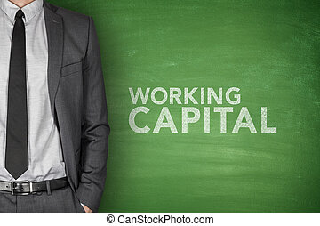 Working capital on blackboard - Working capital on green...