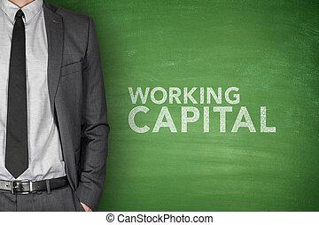 Working capital on blackboard - Working capital on green...
