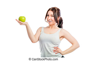 brunette holding a green apple in the palm of your hand