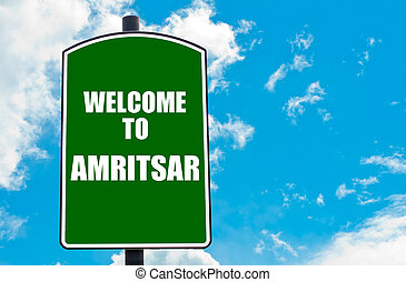 Welcome to AMRITSAR - Green road sign with greeting message...
