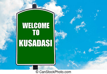 Welcome to KUSADASI - Green road sign with greeting message...