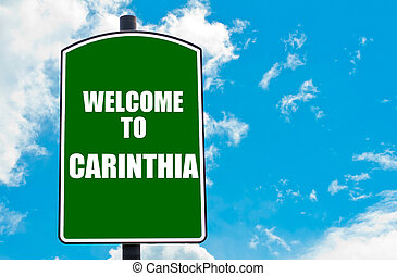 Welcome to CARINTHIA - Green road sign with greeting message...
