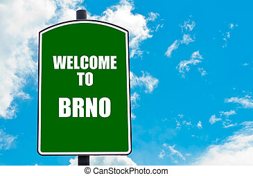 Welcome to BRNO - Green road sign with greeting message...