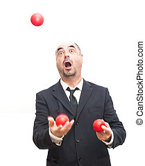 Businessman that is juggling with a red balls - Businessman...