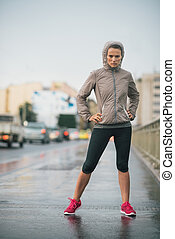Woman runner wearing rain gear feeling determined - Just try...
