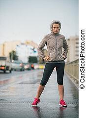 Woman runner wearing rain gear feeling determined - Just try...