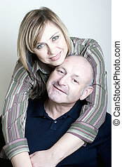 Portrait of happy middle age couple husband and wife smiling