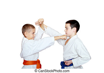 Athletes train punch and protection - Two athletes train...