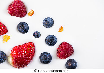 fresh berries fruits isolated on greek yogurt, healthy...
