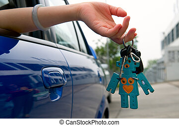 Holding car key - Hand holding the car key with lovely key...