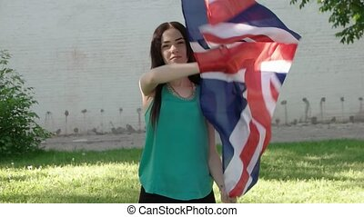 Girl having fun with Union Jack outdoors