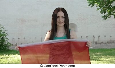 Canada day fun. Girl with canadian flag outdoors