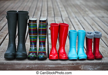 Five pairs of a colorful rain boots Family concept
