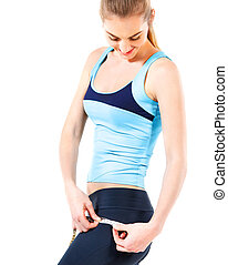 Young woman measuring her hips with measuring tape