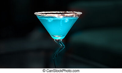 blue cocktail on dark isolated background