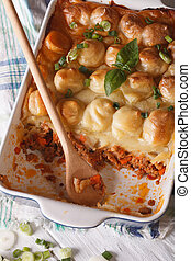 shepherds pie in the baking dish closeup vertical top view -...