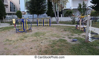 woman exercising with exercise equipment in the public park...