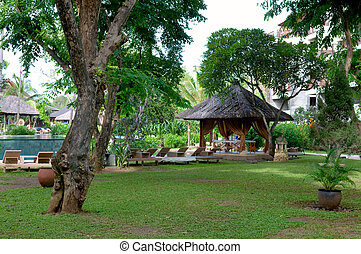 Hut at tropical resort - The garden of tropical resort with...