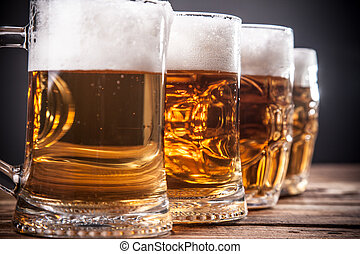 Mug of beer, on a wooden background