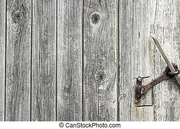 Fragment of old wooden door. Texture. Background.