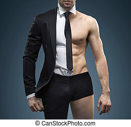 Conceptual image of muscular fit businessman