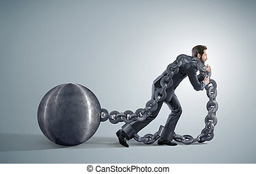 Tired businessman dragging heavy chains - Exhausted...