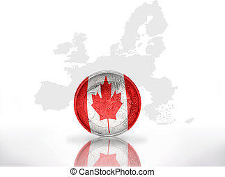 euro coin with canadian flag on the european union map...
