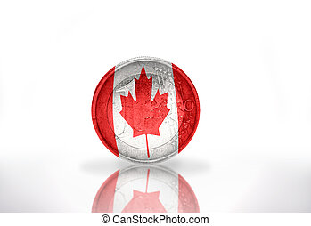 euro coin with canadian flag on the white background