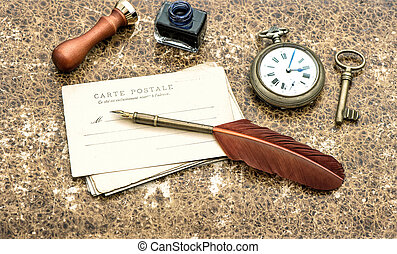 Old post cards, pocket watch, key and feather pen -...