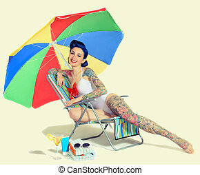 woman in the beach chair retro - beautiful girl with tattoos...
