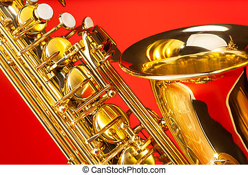 Close-up view of alto saxophone with bell and keys on the...