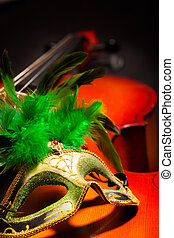 Close view of Venetian mask with on violoncello