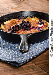 Blueberry croissant breakfast in skillet - Cast iron skillet...