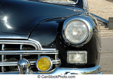 The right headlight of the old automobile