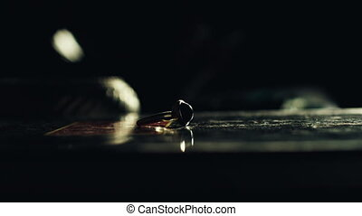 Ring in darkness - Beautiful ring on table with male hand...