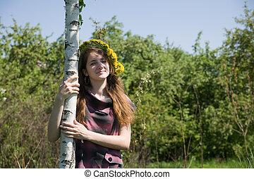 girl near birch - long-haired teen girl in a chaplet near...