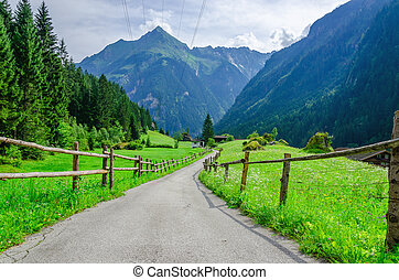 High peaks of the Alps with coutry road, Austria - Country...