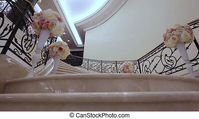 Wedding ceremony - stairs decorated with flowers hall