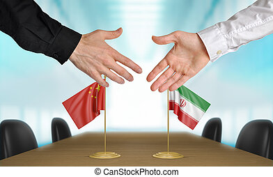 China and Iran diplomats agreeing on a deal.