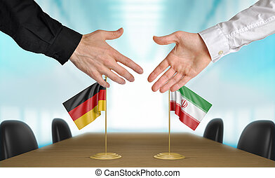 Germany and Iran diplomats agreeing on a deal.