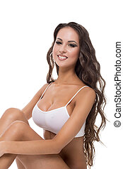 Busty athletic model smiling happily at camera, isolated on...