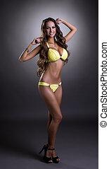 Image of sexy glamorous woman posing in bikini