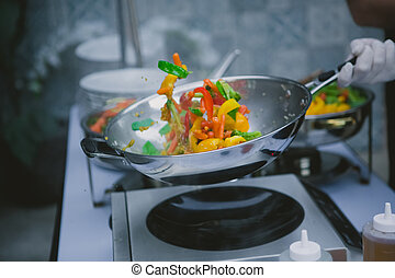 cooking vegetables in wok pan - Chef cooking vegetables in...