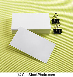 Business cards - Stack of blank business cards on a green...
