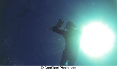 scuba diver silhouette - Silhouette of men with sun disk...