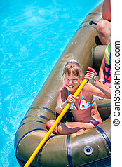 Family ride rubber boat - Family ride rubber boat in water...