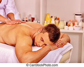 Man getting massage in spa. - Man getting relaxing massage...