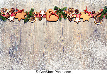 Christmas background with cookies, fir branches and spices...