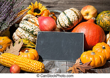 Thanksgiving day autumnal still life with pumpkins and...