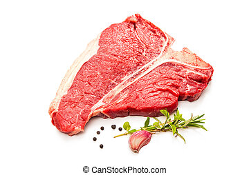 Raw fresh meat T-bone steak and seasoning isolated on white...